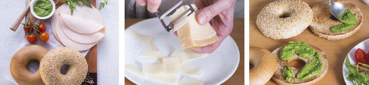 Vollkornbagel mit Hähnchenbrust, Rucola, Cocktailtomaten und Pesto